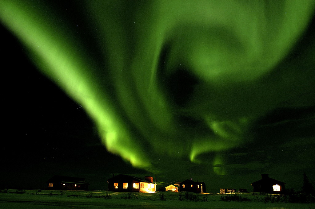 Northern lights over Dymond Lake Ecolodge. Dennis Fast photo.